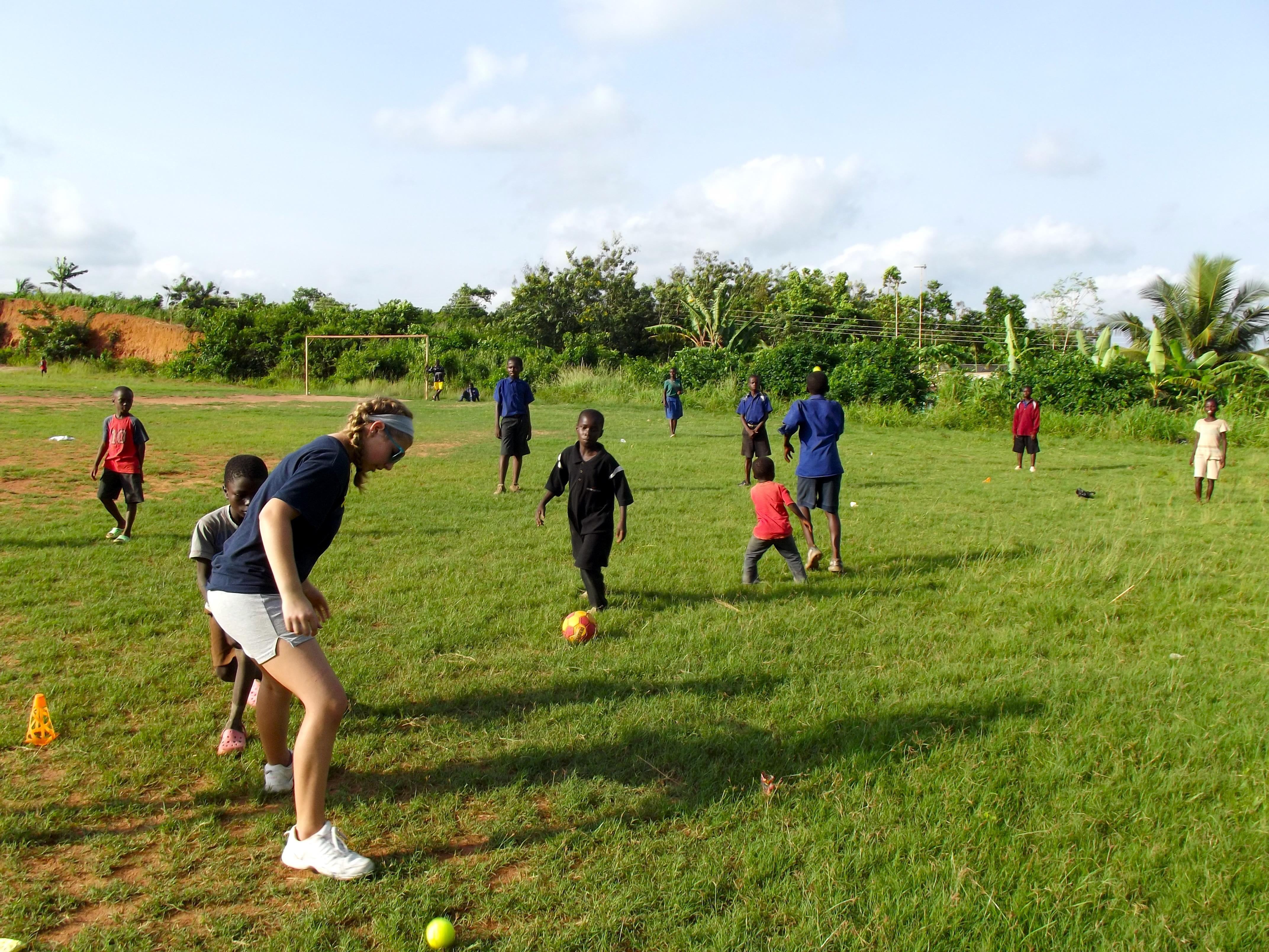 Projects Abroad volunteers taking part in football coaching for high school students in Ghana help improve the skills of their students.